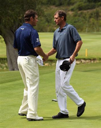CASARES, SPAIN - MAY 19:  Lee Westwood of England (left) shakes hands with Anders Hansen of Denmark after defeating him 6&5 during the group stages of the Volvo World Match Play Championship at Finca Cortesin on May 19, 2011 in Casares, Spain.  (Photo by Andrew Redington/Getty Images)