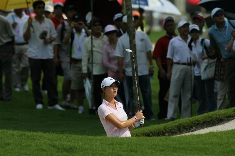 KUALA LUMPUR, MALAYSIA - OCTOBER 23: Michelle Wie of USA watches her bunker shot on the 1st hole during Round Two of the Sime Darby LPGA on October 23, 2010 at the Kuala Lumpur Golf and Country Club in Kuala Lumpur, Malaysia. (Photo by Stanley Chou/Getty Images)