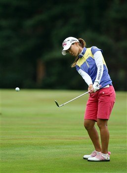 SUNNINGDALE, UNITED KINGDOM - AUGUST 03:  Momoko Ueda of Japan hits her second shot at the 9th hole during the final round of the 2008  Ricoh Women's British Open Championship held on the Old Course at Sunningdale Golf Club, on August 3, 2008 in Sunningdale, England.  (Photo by David Cannon/Getty Images)