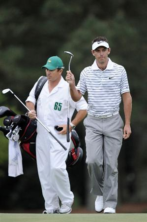 AUGUSTA, GA - APRIL 08:  Charl Schwartzel of South Africa walks with his caddie Wynand Strander to the 18th green during the first round of the 2010 Masters Tournament at Augusta National Golf Club on April 8, 2010 in Augusta, Georgia.  (Photo by Harry How/Getty Images)