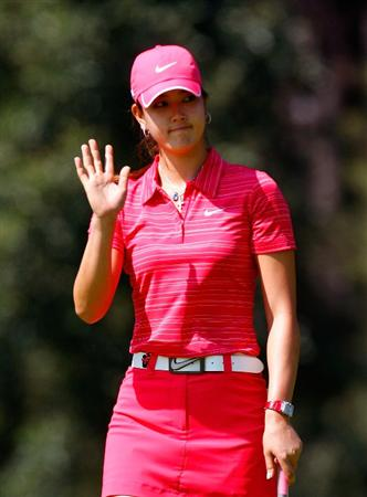 GUADALAJARA, MEXICO - NOVEMBER 15:  Michelle Wie of the United States reacts after her birdie putt on the first green during the final round of the Lorena Ochoa Invitational Presented by Banamex and Corona at Guadalajara Country Club on November 15, 2009 in Guadalajara, Mexico.  (Photo by Kevin C. Cox/Getty Images)