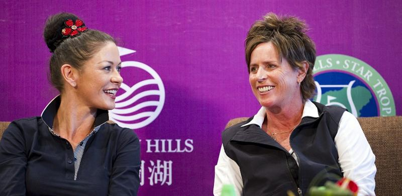 HAIKOU, CHINA - OCTOBER 28: Actress Catherine Zeta-Jones (L) and Solheim Cup's captain Rosie Jones of the USA attend a press conference during the Mission Hills Star Trophy on October 28, 2010 in Haikou, China. The Mission Hills Star Trophy is Asia's leading leisure liflestyle event and features Hollywood celebrities and international golf stars.  (Photo by Victor Fraile/Getty Images)