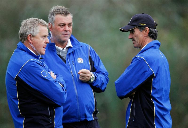 NEWPORT, WALES - SEPTEMBER 28:  Europe Team Captain Colin Montgomerie (L) and Assistant Darren Clarke chat with Edoardo Molinari's caddie Colin Byrne during a practice round prior to the 2010 Ryder Cup at the Celtic Manor Resort on September 28, 2010 in Newport, Wales.  (Photo by Sam Greenwood/Getty Images)