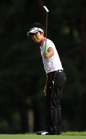 KAWAGOE CITY, JAPAN - OCTOBER 08:  Yosuke Asaji of Japan reacts to a putt on the 11th hole during the second round of the 2010 Asian Amateur Championship at Kasumigaseki Country Club on October 8, 2010 in Kawagoe City, Japan.  (Photo by Streeter Lecka/Getty Images)