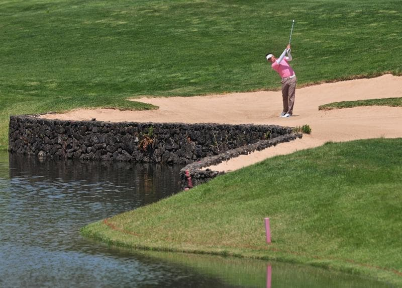 JEJU, SOUTH KOREA - APRIL 23:  Zane Scotland of England plays his approach shot on the 18th hole during the first round of the Ballantine's Championship at Pinx Golf Club on April 23, 2009 in Jeju, South Korea.  (Photo by Stuart Franklin/Getty Images)