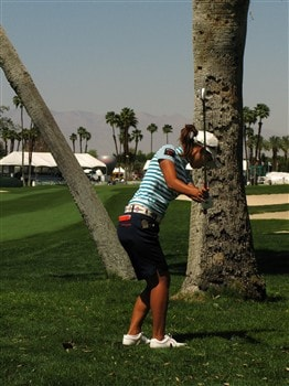 RANCHO MIRAGE, CA - APRIL 3:  Momoko Ueda of Japan chips out from a lie behind a tree on the 18th hole during the first round of the Kraft Nabisco Championship at Mission Hills Country Club April 3, 2008 in Rancho Mirage, California.  (Photo by Stephen Dunn/Getty Images)