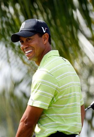 DORAL, FL - MARCH 14:  Tiger Woods smiles prior to hitting his first shot on the 5th hole during the third round of the World Golf Championships-CA Championship on March 14, 2009 at the Doral Golf Resort and Spa in Miami, Florida.  (Photo by Jamie Squire/Getty Images)