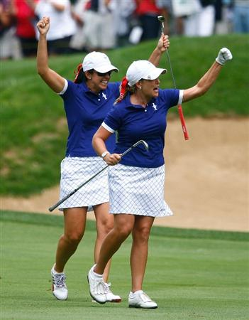 SUGAR GROVE, IL - AUGUST 22:  (L-R) Cristie Kerr and Nicole Castrale of the U.S. Team celebrate after Kerr holed out for eagle on the 12th hole during the saturday morning fourball matches at the 2009 Solheim Cup at Rich Harvest Farms on August 22, 2009 in Sugar Grove, Illinois.  (Photo by Scott Halleran/Getty Images)