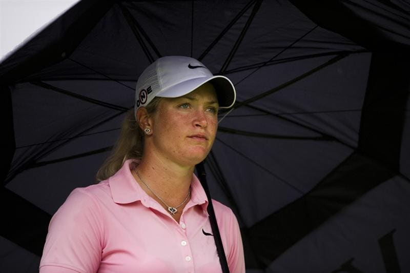 CHON BURI, THAILAND - FEBRUARY 20:  Suzann Pettersen of Norway shelters from the rain under her umbrella on the 3rd hole during round three of the Honda PTT LPGA Thailand at Siam Country Club on February 20, 2010 in Chon Buri, Thailand.  (Photo by Victor Fraile/Getty Images)