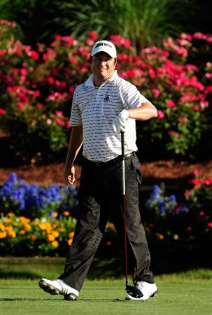 PONTE VEDRA BEACH, FL - MAY 09:  Tim Clark of South Africa smiles as he walks off the 18th tee during the final round of THE PLAYERS Championship held at THE PLAYERS Stadium course at TPC Sawgrass on May 9, 2010 in Ponte Vedra Beach, Florida.  (Photo by Sam Greenwood/Getty Images)