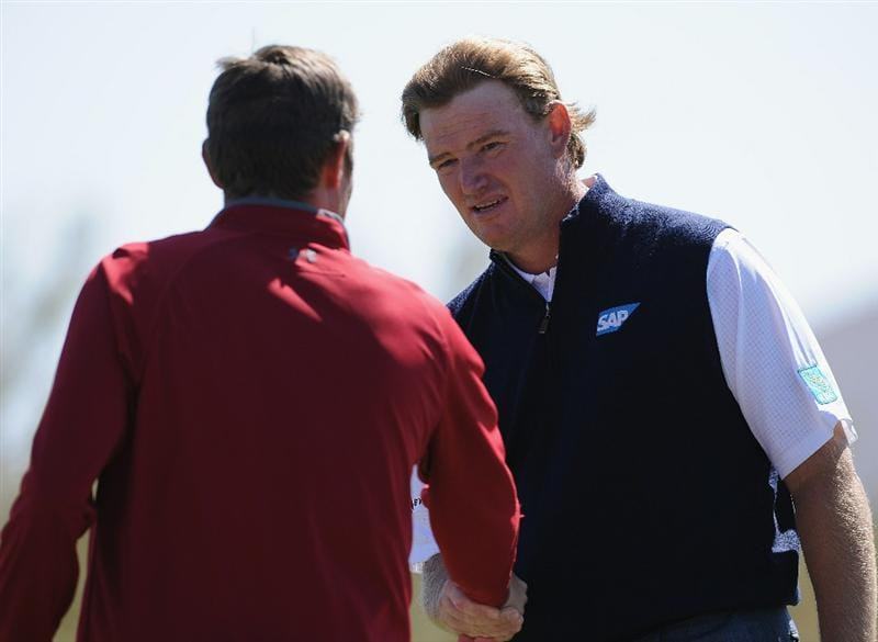 MARANA, AZ - FEBRUARY 23:  Jeff Overton congratulates  Ernie Els of South Africa on the first extra hole during the first round of the World Golf Championships-Accenture Match Play Championship held at The Ritz-Carlton Golf Club, Dove Mountain on February 23, 2011 in Marana, Arizona.  (Photo by Stuart Franklin/Getty Images)