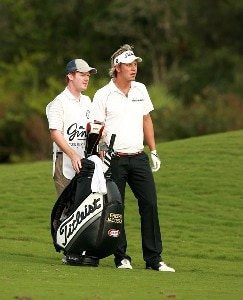 Fredrik Jacobson and his caddie consider their options in the fairway on the 18th hole during the final round of the Ginn Sur Mer Classic at Tesoro on October 29, 2007 in Port Saint Lucie, Florida. PGA TOUR - 2007 Ginn sur Mer Classic - Final RoundPhoto by Doug Benc/WireImage.com