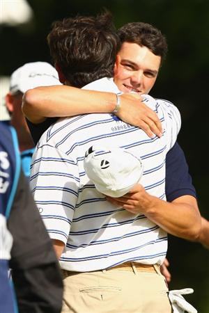 LUSS, UNITED KINGDOM - JULY 12:  Martin Kaymer of Germany hugs Gonzalo Fernandez-Castano of Spain following his victory during the Final Round of The Barclays Scottish Open at Loch Lomond Golf Club on July 12, 2009 in Luss, Scotland. (Photo by Richard Heathcote/Getty Images)