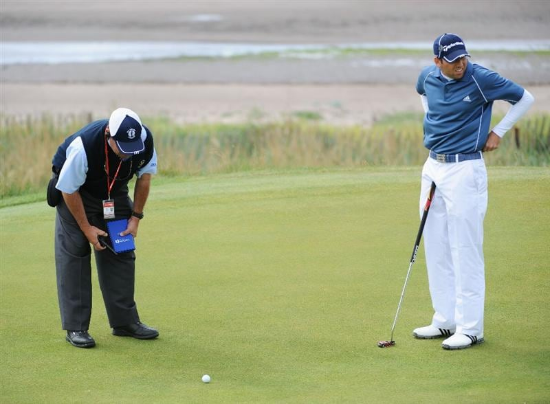 TURNBERRY, SCOTLAND - JULY 18:  Sergio Garcia of Spain consults with a Rules Official on the 4th green during round three of the 138th Open Championship on the Ailsa Course, Turnberry Golf Club on July 18, 2009 in Turnberry, Scotland.  (Photo by Harry How/Getty Images)