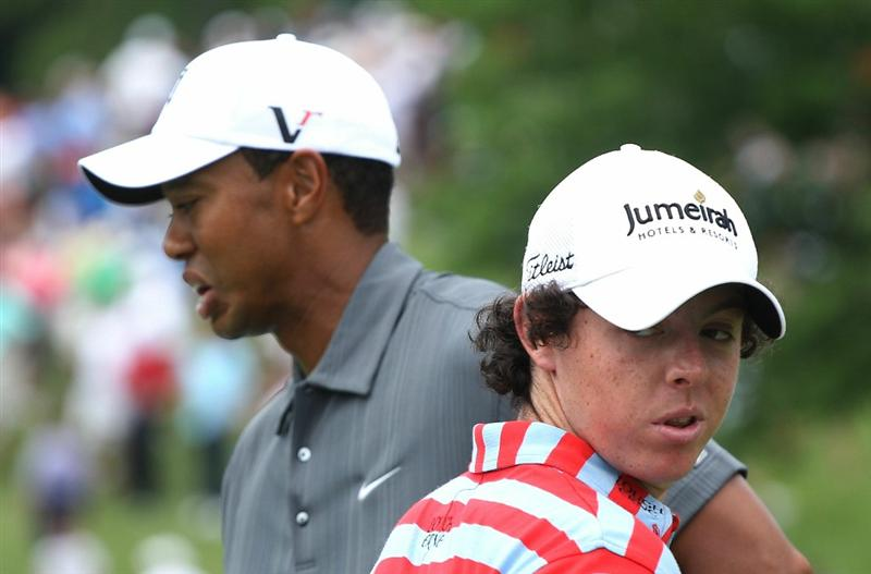 DUBLIN, OH - JUNE 02:  Tiger Woods (L) and Rory McIlroy of Northern Ireland wait in a fairway during the Memorial Skins Game prior to the start of the 2010 Memorial Tournament at the Muirfield Village Golf Club on June 2, 2010 in Dublin, Ohio.  (Photo by Scott Halleran/Getty Images)