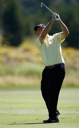 SUNRIVER, OR - AUGUST 21:  Tom Lehman hits his second shot on the 9th hole during the second round of the Jeld-Wen Tradition on August 21, 2009 at Crosswater Club at Sunriver Resort in Sunriver, Oregon.  (Photo by Jonathan Ferrey/Getty Images)