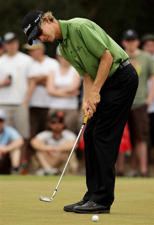 MELBOURNE, AUSTRALIA - NOVEMBER 14:  Peter Nolan of Australia putts on the 1st hole during round three of the 2009 Australian Masters at Kingston Heath Golf Club on November 14, 2009 in Melbourne, Australia.  (Photo by Mark Dadswell/Getty Images)