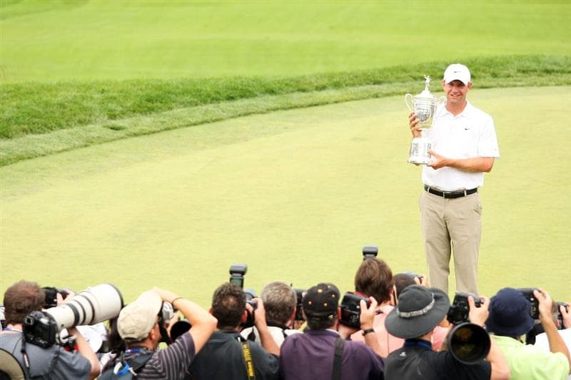 FARMINGDALE, NY - JUNE 22:  Lucas Glover celebrates with the winner's trophy after his two-stroke victory while photographers take his photograph at the 109th U.S. Open on the Black Course at Bethpage State Park on June 22, 2009 in Farmingdale, New York.  (Photo by Ross Kinnaird/Getty Images)