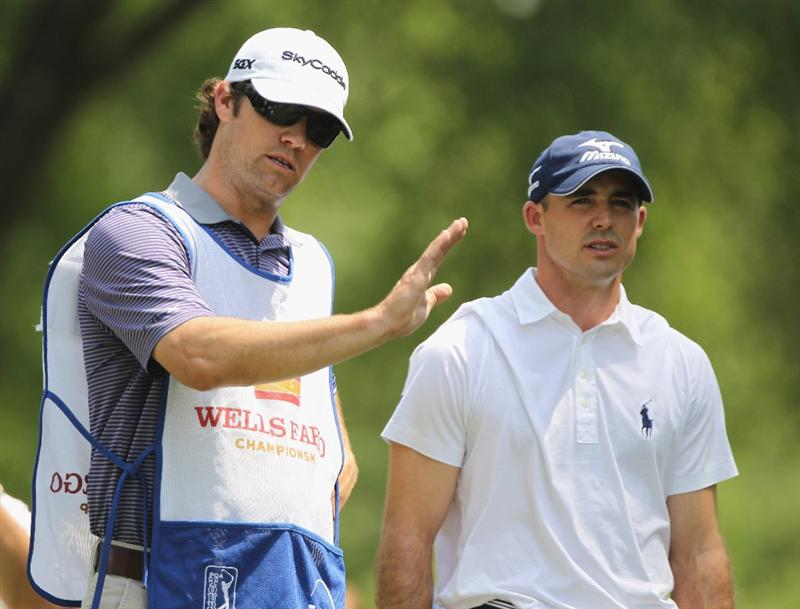 CHARLOTTE, NC - MAY 08:  Jonathan Byrd chats with his cddie Adam Hayes on the fourth hole during the final round of the Wells Fargo Championship at the Quail Hollow Club on May 8, 2011 in Charlotte, North Carolina.  (Photo by Scott Halleran/Getty Images)