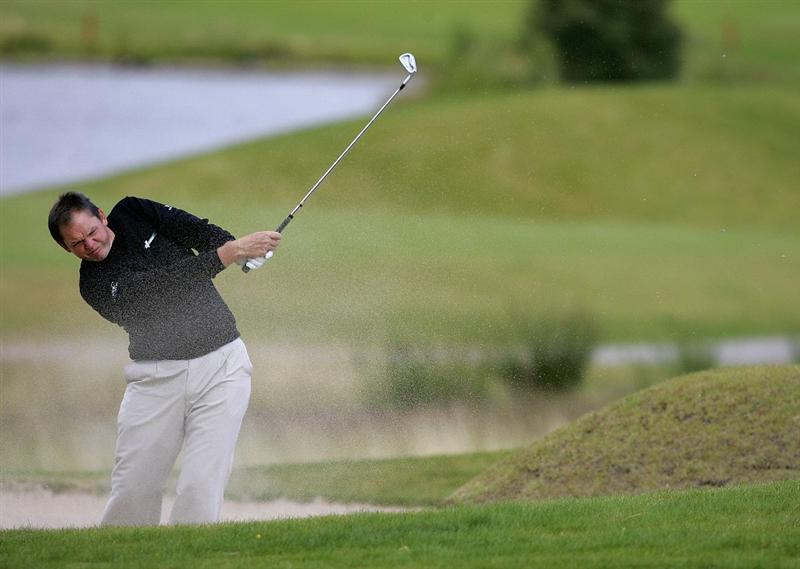 INVERNESS, SCOTLAND - AUGUST 01: Jamie McLeary of Scotland plays out of the bunker on the 17th hole during the Scottish Hydro Challenge at the Macdonald Spey Valley Golf Course on August 01, 2009 in Inverness, Scotland. (Photo by Tom Dulat/Getty Images)