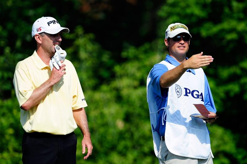 CHASKA, MN - AUGUST 14:  (L-R) Kevin Sutherland talks with his caddie Shawn Seagars on the tenth tee during the second round of the 91st PGA Championship at Hazeltine National Golf Club on August 14, 2009 in Chaska, Minnesota.  (Photo by Sam Greenwood/Getty Images)