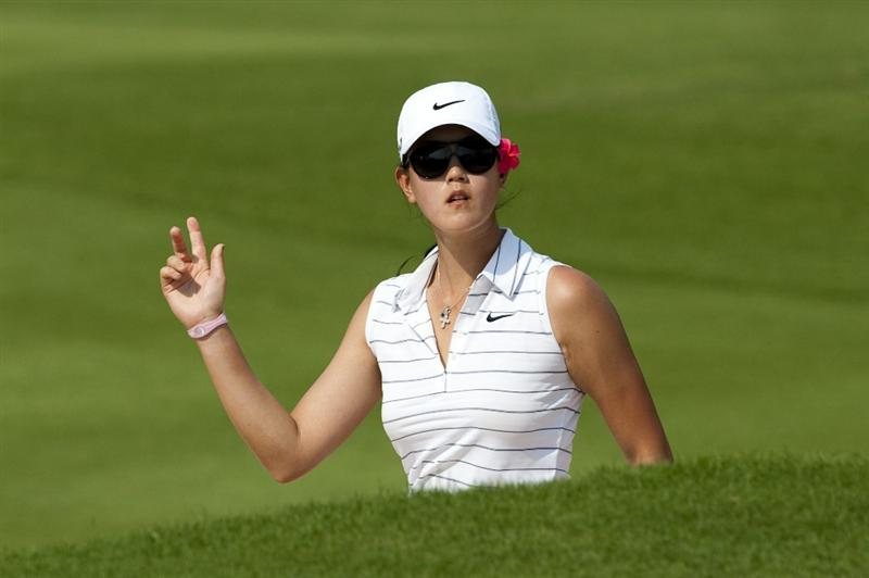 CHON BURI, THAILAND - FEBRUARY 19:  Michelle Wie of USA acknowledges the crowd on the 12th hole during day three of the LPGA Thailand at Siam Country Club on February 19, 2011 in Chon Buri, Thailand.  (Photo by Victor Fraile/Getty Images)