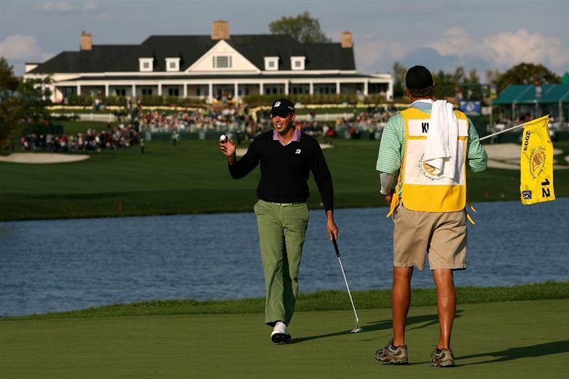 VERONA, NY - OCTOBER 04:  Matt Kuchar acknowledges the crowd following his birdie putt on the 12th green during the final round of the 2009 Turning Stone Resort Championship at Atunyote Golf Club held on October 4, 2009 in Verona, New York.  (Photo by Chris Trotman/Getty Images)