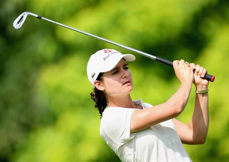 SINGAPORE - MARCH 06:  Lorena Ochoa of Mexico plays her third shot on the par five 5th hole during the second round of HSBC Women's Champions at the Tanah Merah Country Club on March 6, 2009 in Singapore.  (Photo by Ross Kinnaird/Getty Images)