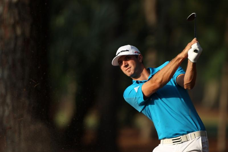 PONTE VEDRA BEACH, FL - MAY 04:  Dustin Johnson hits a shot during a practice round prior to the start of THE PLAYERS Championship held at THE PLAYERS Stadium course at TPC Sawgrass on May 4, 2010 in Ponte Vedra Beach, Florida.  (Photo by Scott Halleran/Getty Images)