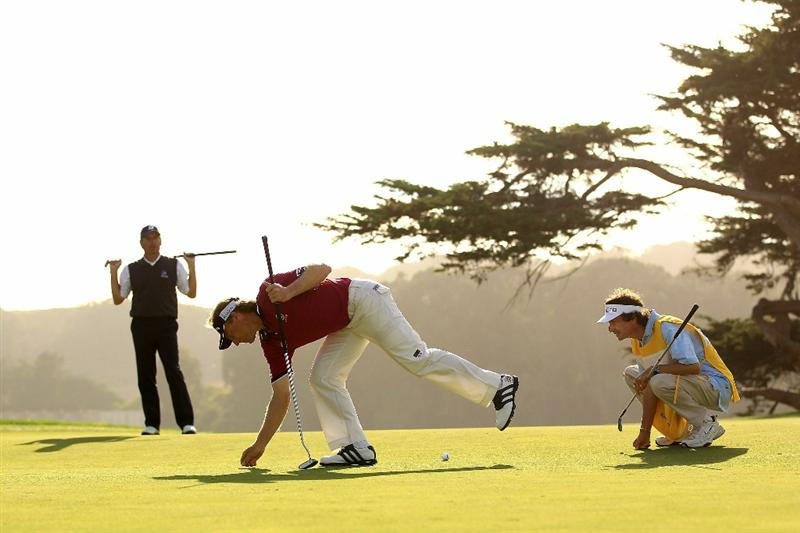 SAN FRANCISCO - NOVEMBER 04:  Bernhard Langer of Germany lines up a putt on the 16th hole while Fred Couples and Langers caddie look on during round 1 of the Charles Schwab Cup Championship at Harding Park Golf Course on November 4, 2010 in San Francisco, California.  (Photo by Ezra Shaw/Getty Images)