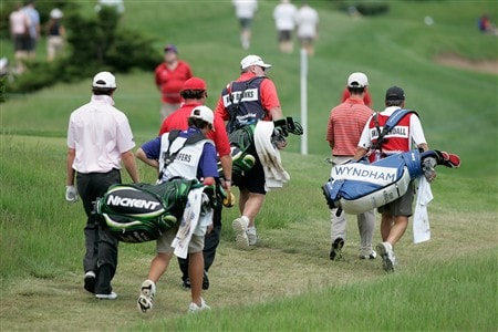 GLENVIEW, IL - MAY 31: The leaders, Kris Blanks, Skip Kendall and Kyle Reifers, along with their caddy's walk on the fairway to the next hole during Round Three of the Bank of America Open at The Glen Club on May 31, 2008 in Glenview, Illinois. (Photo by Scott Boehm/Getty Images)