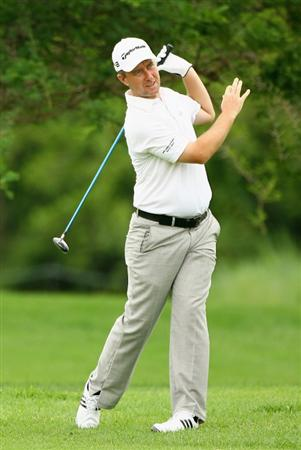 NELSPRUIT, SOUTH AFRICA - DECEMBER 12:  Mark Foster of England reacts to a poor second shot onto the second green during the second round of the Alfred Dunhill Championship at Leopard Creek Country Club on December 12, 2008 in Malelane, South Africa.  (Photo by Warren Little/Getty Images)