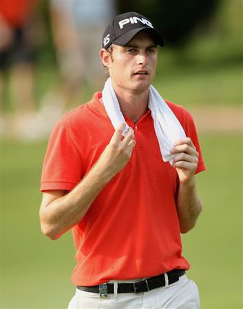 KUALA LUMPUR, MALAYSIA - MARCH 06:  Rhys Davies of Wales walks towards his ball on the 18th hole during the the third round of the Maybank Malaysian Open at the Kuala Lumpur Golf and Country Club on March 6, 2010 in Kuala Lumpur, Malaysia.  (Photo by Andrew Redington/Getty Images)