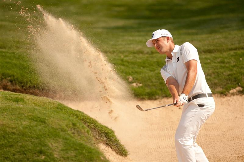 SAN ANTONIO, TX - APRIL 16: Kevin Chappell follows through on a bunker shot during the third round of the Valero Texas Open at the AT&T Oaks Course at TPC San Antonio on April 16, 2011 in San Antonio, Texas. (Photo by Darren Carroll/Getty Images)