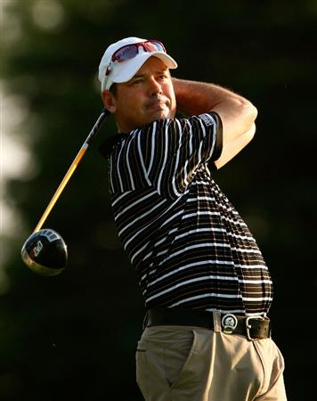 CHASKA, MN - AUGUST 11:  Rich Beem hits a shot during the second preview day of the 91st PGA Championship at Hazeltine Golf Club on August 11, 2009 in Chaska, Minnesota.  (Photo by Scott Halleran/Getty Images)