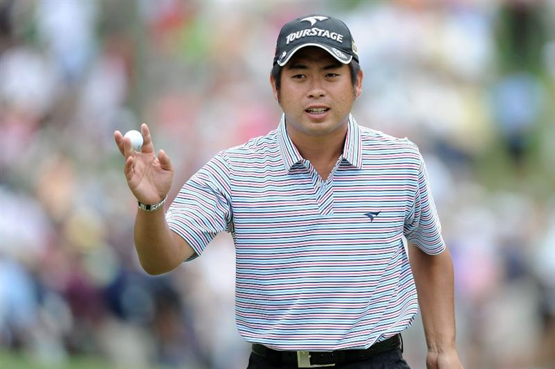 AUGUSTA, GA - APRIL 08:  Yuta Ikeda of Japan waves to the gallery on the sixth green during the first round of the 2010 Masters Tournament at Augusta National Golf Club on April 8, 2010 in Augusta, Georgia.  (Photo by Harry How/Getty Images)