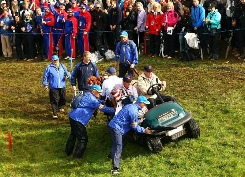 NEWPORT, WALES - OCTOBER 03:  Marshals help members of the USA team with their buggy during the Fourball & Foursome Matches during the 2010 Ryder Cup at the Celtic Manor Resort on October 3, 2010 in Newport, Wales. (Photo by Richard Heathcote/Getty Images)