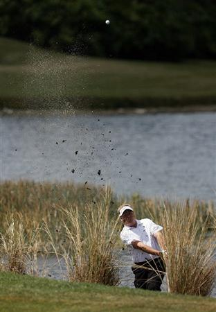 PALM BEACH GARDENS, FL - MARCH 05:  Carl Pettersson hits out of the water hazard on the sixth fairway during the first round of The Honda Classic at PGA National Resort and Spa on March 5, 2009 in Palm Beach Gardens, Florida.  (Photo by Doug Benc/Getty Images)