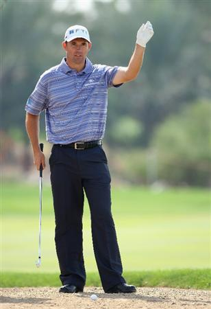 ABU DHABI, UNITED ARAB EMIRATES - JANUARY 17:  Padraig Harrington of Ireland prepares to play his second shot on the ninth hole during the third round of The Abu Dhabi Golf Championship at Abu Dhabi Golf Club on January 17, 2009 in Abu Dhabi, United Arab Emirates.  (Photo by Andrew Redington/Getty Images)
