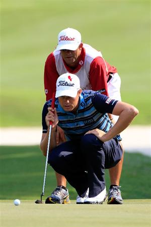 PONTE VEDRA BEACH, FL - MAY 12:  Nick Watney lines up a putt on the 16th hole with the help of caddie Chad Reynolds during the first round of THE PLAYERS Championship held at THE PLAYERS Stadium course at TPC Sawgrass on May 12, 2011 in Ponte Vedra Beach, Florida.  (Photo by Sam Greenwood/Getty Images)