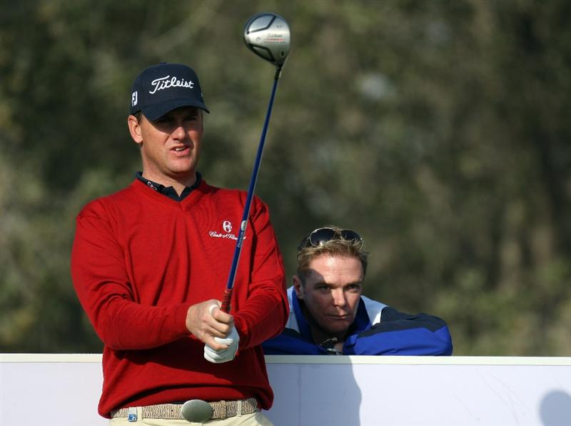 DOHA, QATAR - JANUARY 21:  Robert Karlsson of Sweden is watched by his caddie Gareth Lord while on the 2nd tee during the pro-am event prior to the Commercialbank Qatar Masters at the Doha Golf Club on January 21, 2009 in Doha, Qatar.  (Photo by Ross Kinnaird/Getty Images)