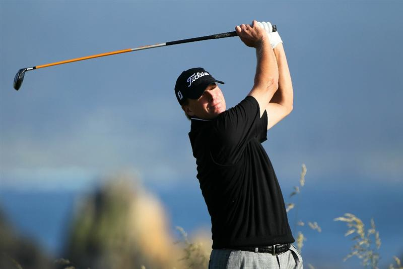 PEBBLE BEACH, CA - JUNE 17:  Steve Stricker hits a tee shot on the 18th hole during the first round of the 110th U.S. Open at Pebble Beach Golf Links on June 17, 2010 in Pebble Beach, California.  (Photo by Donald Miralle/Getty Images)