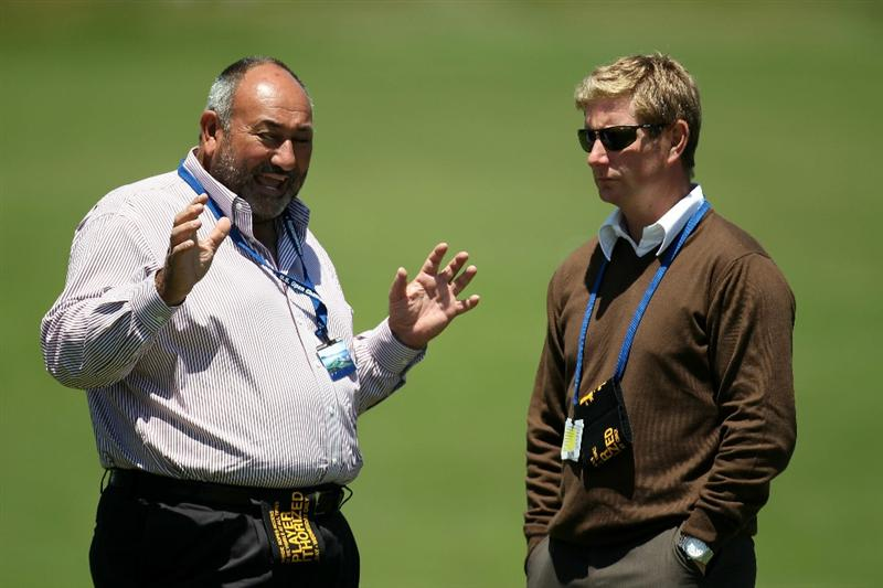 PEBBLE BEACH, CA - JUNE 16:  Andrew 'Chubby' Chandler, managing director of ISM, talks with ISM employee Stuart Cage during a practice round prior to the start of the 110th U.S. Open at Pebble Beach Golf Links on June 16, 2010 in Pebble Beach, California.  (Photo by Ross Kinnaird/Getty Images)