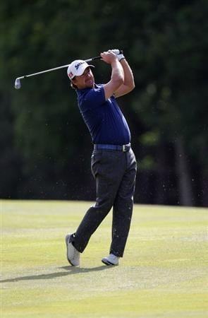 VIRGINIA WATER, ENGLAND - MAY 25:  Graeme McDowell of Northern Ireland plays an approach shot during the Pro-Am round prior to the BMW PGA Championship at Wentworth Club on May 25, 2011 in Virginia Water, England.  (Photo by Ross Kinnaird/Getty Images)