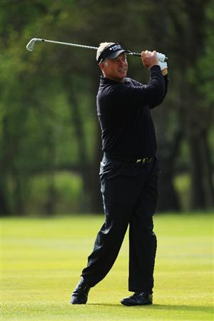 VIRGINIA WATER, ENGLAND - MAY 19:  Darren Clarke of Northern Ireland plays an iron shot during the Pro-Am round prior to the BMW PGA Championship on the West Course at Wentworth on May 19, 2010 in Virginia Water, England.  (Photo by Warren Little/Getty Images)