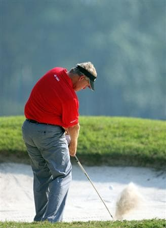 HONG KONG, CHINA - NOVEMBER 23:  Colin Montgomerie of Scotland plays his bunker shot on the 13th hole during the final round of the UBS Hong Kong Open at the Hong Kong Golf Club on November 23, 2008 in Fanling, Hong Kong.  (Photo by Stuart Franklin/Getty Images)