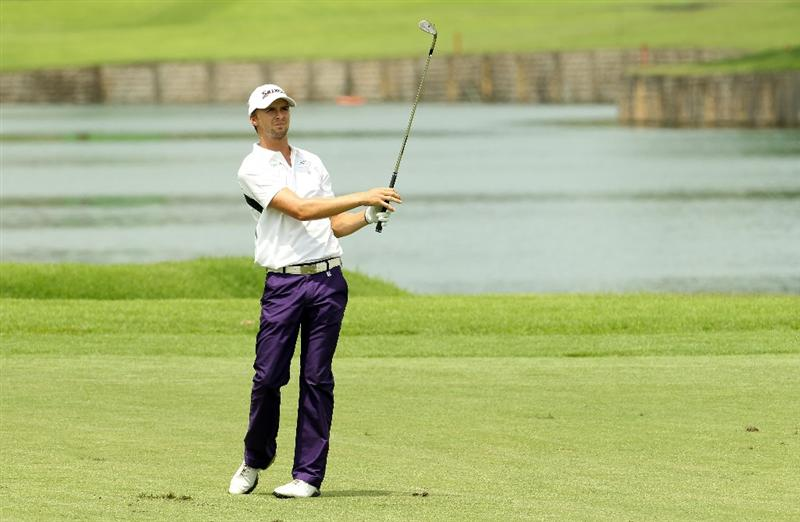 SINGAPORE - NOVEMBER 12:  Rikard Karlberg of Sweden in action during the Second Round of the Barclays Singapore Open at Sentosa Golf Club on November 12, 2010 in Singapore, Singapore.  (Photo by Ian Walton/Getty Images)