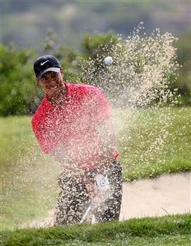SAN DIEGO - JUNE 16:  Tiger Woods hits out of the bunker on the third hole during the playoff round of the 108th U.S. Open at the Torrey Pines Golf Course (South Course) on June 16, 2008 in San Diego, California.  (Photo by Ross Kinnaird/Getty Images)