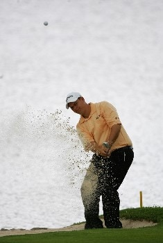 MALELANE, SOUTH AFRICA - DECEMBER 07:  Mark Cayeux of Zimbabwe plays out of the greenisde bunker on the 16th green during the second round of The Alfred Dunhill Championship at The Leopard Creek Country Club on December 7, 2007 in Malelane, South Africa.  (Photo by Warren Little/Getty Images)