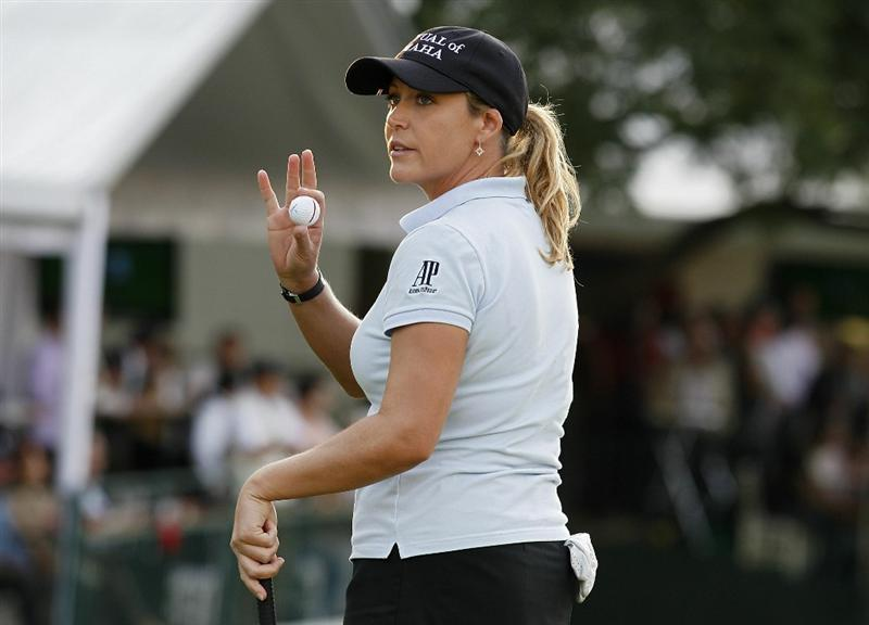 GUADALAJARA, MEXICO - NOVEMBER 11:  Christie Kerr of the United States holds up her ball after finishing with the lead at eight under par during the first round of the Lorena Ochoa Invitational Presented by Banamex and Corona Light at Guadalajara Country Club on November 11, 2010 in Guadalajara, Mexico.  (Photo by Michael Cohen/Getty Images)